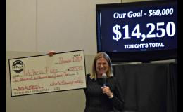 Pam Brulotte of Icicle Brewing holds a big check